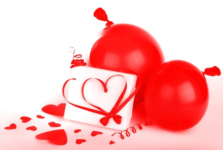 Gift box with red hearts & ribbon isolated on white background, conceptual image of love & Valentine's day holiday Stock Photo - 8620549