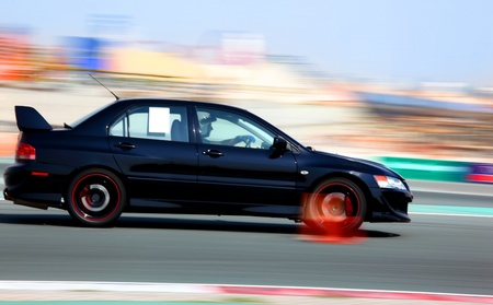 Powerful balck sport car performing at car race championship photo