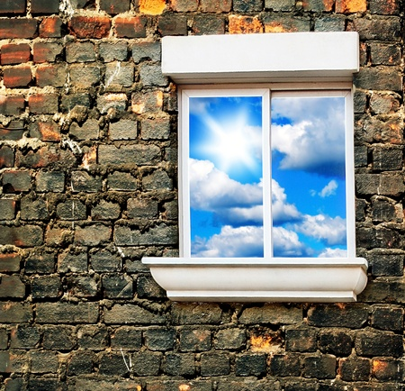 Sky window over old brick wall, conceptual image of freedom photo