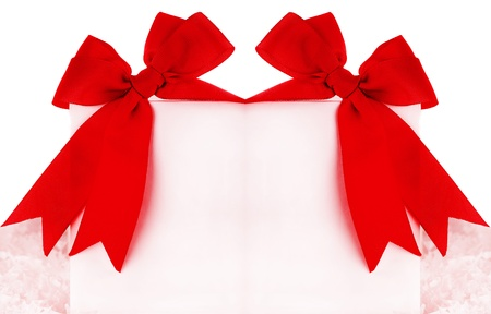 Beautiful red bows over blank greeting card, holiday concept photo