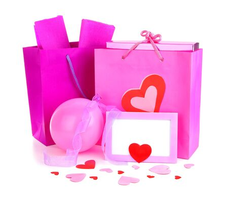 Pink shopping bags with gifts & blank card, isolated on white background, conceptual image of love & Valentine's day holiday Stock Photo - 8749905