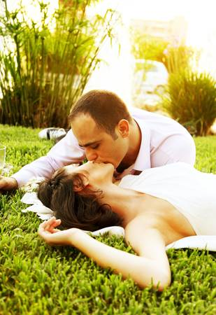 Happy young couple kissing outdoors, wedding day photo