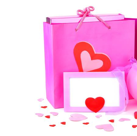 Pink shopping bag with gift & blank card, isolated on white background, conceptual image of love & Valentines day holiday photo
