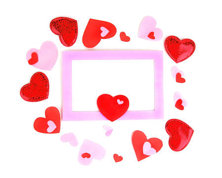 Pink romantic holiday photo frame with hearts isolated on white background photo