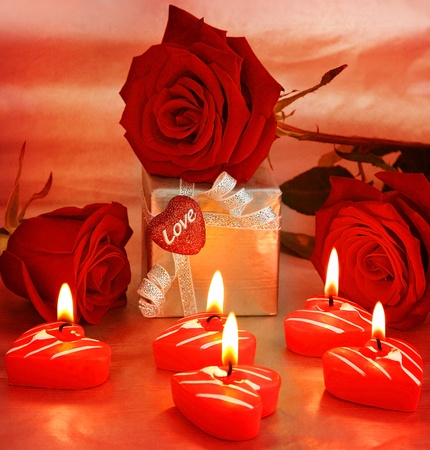 Romantic gift & red roses with candles, love concept photo