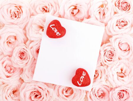 Pink fresh roses background with red hearts & isolated  blank greeting card, love concept Stock Photo - 8749932