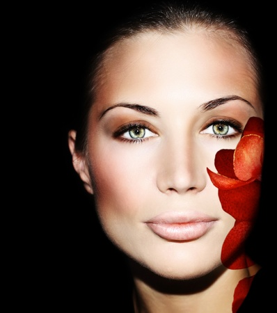 health and beauty: Beautiful female face with flower petals, conceptual image of skincare & youth Stock Photo