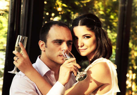 Happy young couple drinking champagne, wedding day photo