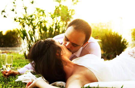 Happy young couple kissing outdoors, wedding day Stock Photo - 8749981
