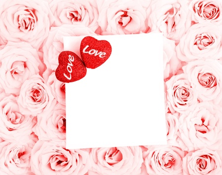 Pink fresh roses background with red hearts & blank greeting card, love concept photo