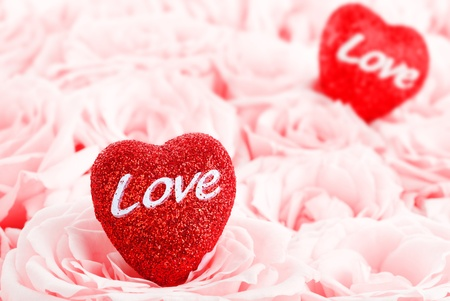Pink fresh roses background with red hearts Stock Photo - 8749977