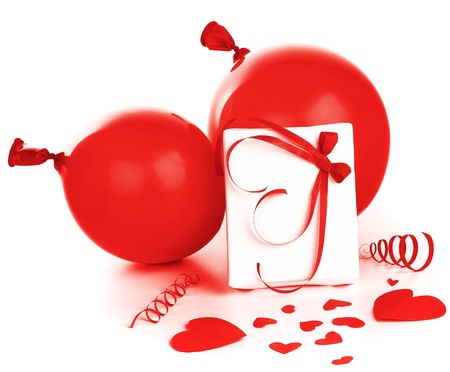Gift box with red hearts & baloons isolated on white background, conceptual image of love & Valentines day holiday photo