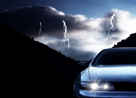 rainstorm: Car at night with thunderstorm
