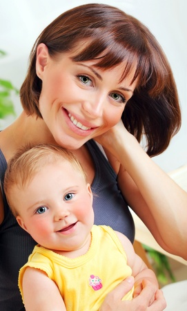 Portrait of a smiling mother & baby, happy family Stock Photo - 8876725