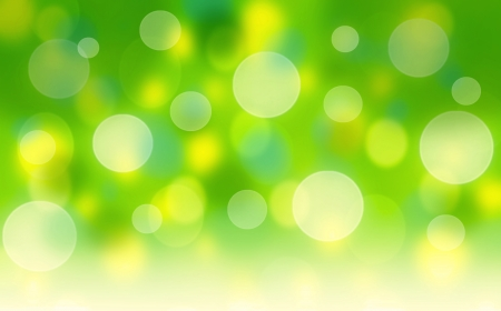 green and yellow: Fresh green abstract spring background with bokeh effect Stock Photo
