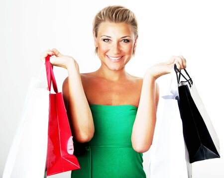 Happy shopping girl carrying new bags, spending money concept Stock Photo - 8876726