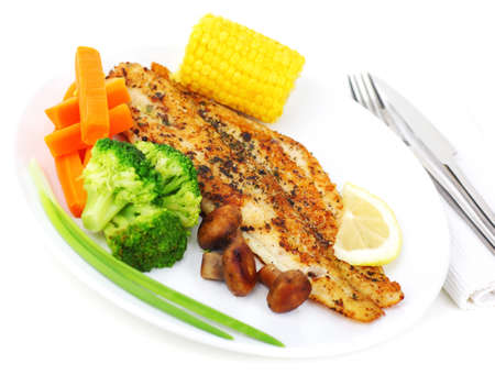 Tasty healthy fish fillet with steamed vegetables photo