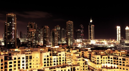 Panoramic image of Dubai downtown at night photo
