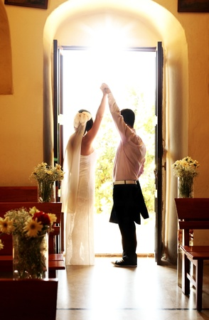family church: Wedding ceremony, happy young couple holding hands, concept of love, family & new beginnings Stock Photo