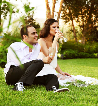 Happy young couple drinking champagne, new family celebrating wedding day Stock Photo
