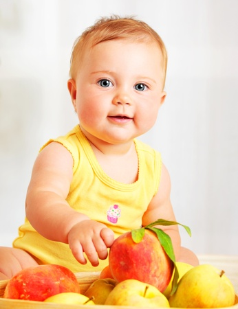 Little baby choosing fruits, closeup portrait, concept of health care & healthy child nutrition Stock Photo - 9059328