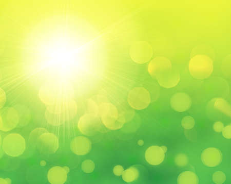 Fresh green abstract spring background with bokeh effect and sun light photo