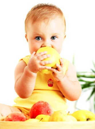 bit: Little baby eating apple, closeup portrait, concept of health care & healthy child nutrition