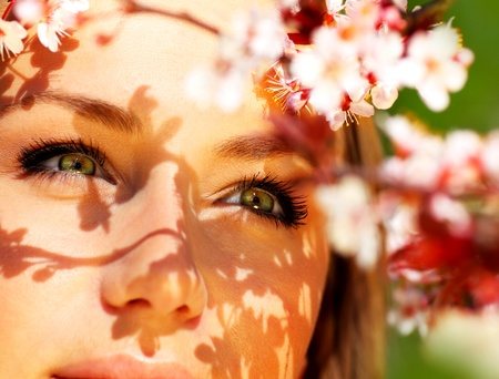 Pretty female face with cherry blossom tree, closeup outdoor portrait Stock Photo - 9327304