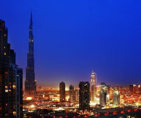 Dubai downtown night scene with city lights photo