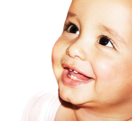 girl teeth: Closeup portrait of beautiful happy baby face over white background