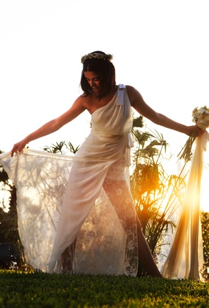 Happy bride over sunset, wedding day Stock Photo - 9452815