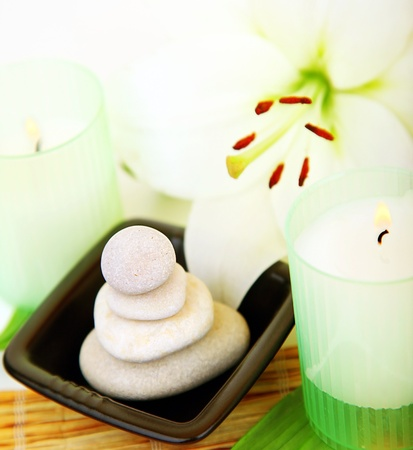 Candles and balanced zen spa stones with lily flower, relaxation vacation concept Stock Photo - 9482357
