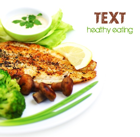 seafood dinner: Tasty healthy fish fillet with steamed vegetables, isolated on white background, border with text space?