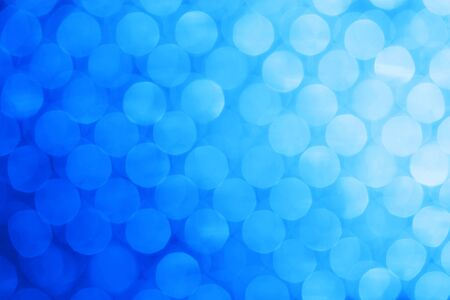Bright holiday background bokeh with magic blur blue lights photo