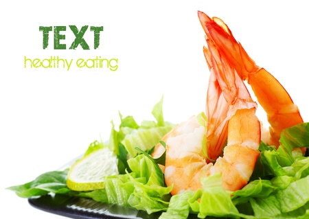 sea food: Green salad with shrimps, border isolated on white background, healthy eating concept