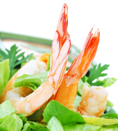 Green salad with shrimps isolated on white background, healthy eating concept