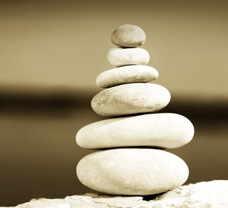 zen stones: Zen balance stones sepia toned, conceptual image of relaxation & vacation Stock Photo