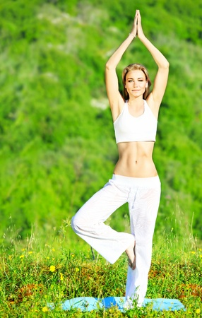 Healthy yoga woman exercising outdoor, fitness & sport lifestyle concept Imagens - 9661336
