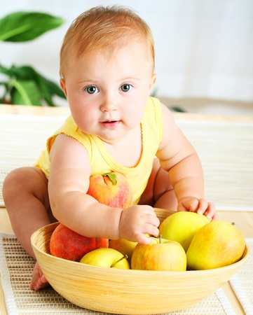 baby girls: Little baby choosing fruits, closeup portrait, concept of health care & healthy child nutrition