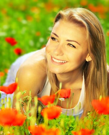 Young beautiful girl enjoying on the poppy flowers field, outdoor portrait, summer fun concept Reklamní fotografie