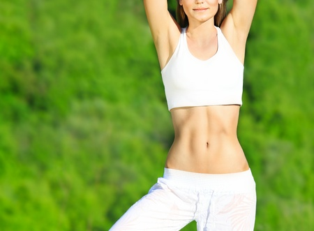 body posture: Healthy sport female body over green natural background, body care & fitness concept