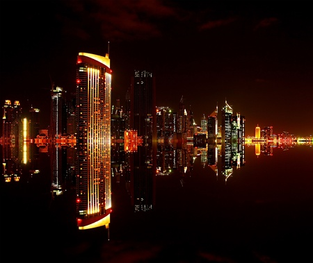 Dubai downtown at night with reflection in water, modern design of new city Stock Photo - 9763221