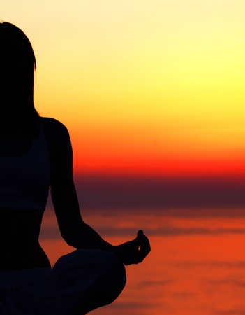yoga meditation: Healthy woman doing yoga outdoor, sunset over sea, body care & meditation concept