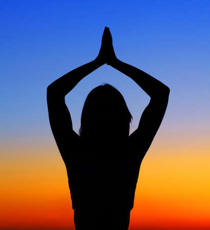 Healthy woman doing yoga outdoor, sunset over sea, body care & meditation concept Stock Photo - 9824642