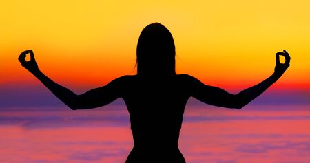 Healthy woman doing yoga outdoor, sunset over sea, body care & meditation concept Stock Photo - 9824655
