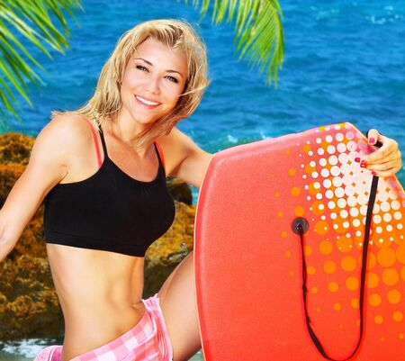 Beautiful sporty female holding body board, outdoor beach portrait, water sport, healthy lifestyle concept Stock Photo - 9824590