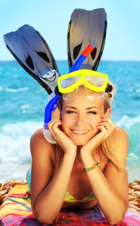 Beautiful female closeup portrait on the beach wearing snorkeling equipment, water sport, healthy lifestyle concept photo