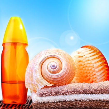 Beach items over blue sky conceptual image of summertime vacation & holidays Stock Photo - 9972799