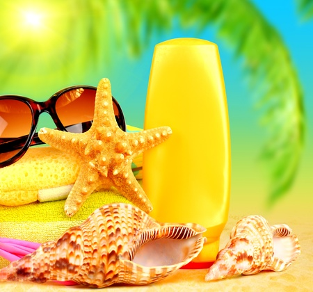 sunscreen: Summertime holidays background, beach objects on the sand, fun of travel concept