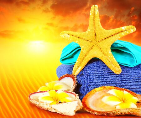 Beach items over sunset conceptual image of summertime vacation and holidays Stock Photo - 9972820
